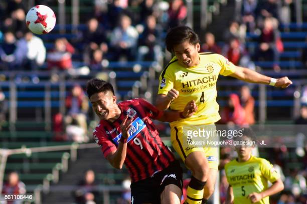 Shinnosuke Nakatani of Kashiwa Reysol and Ken Tokura of Consadole Sapporo compete for the ball during the JLeague J1 match between Consadole Sapporo...