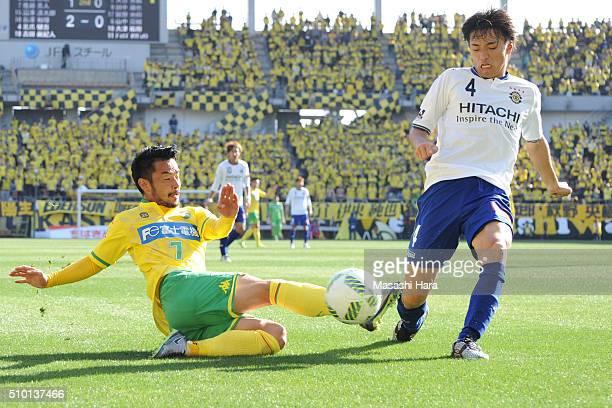 Shinnosuke Nakatani of Kashiwa Reysol and Yuto Sato of JEF United Chiba compete for the ball during the preseason friendly match between JEF United...