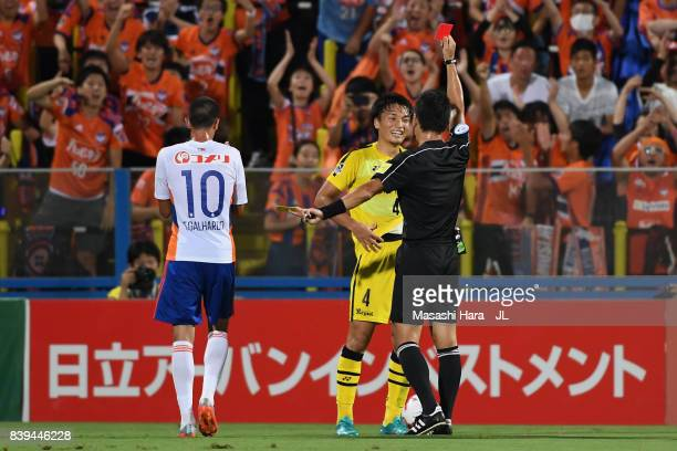 Shinnosuke Nakatani of Kashiwa Reysol is shown a red card by referee Ryuji Sato during the JLeague J1 match between Kashiwa Reysol and Albirex...