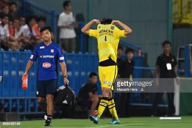Shinnosuke Nakatani of Kashiwa Reysol walks off the pitch after sent off during the JLeague J1 match between Kashiwa Reysol and Albirex Niigata at...