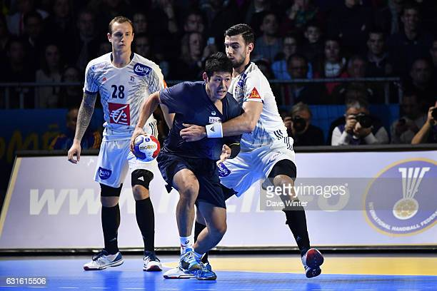 Shinnosuke Tokuda of Japan and Ludovic Fabregas of France during the IHF Men's World Championship match between France and Japan preliminary round...