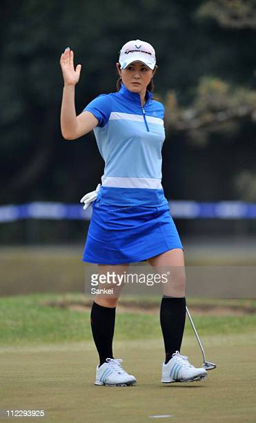 Shinobu Moromizato acknowledges fans after holing the birdie putt on 18th green during the second round of the Nishijin Ladies Classic at Kumamoto...