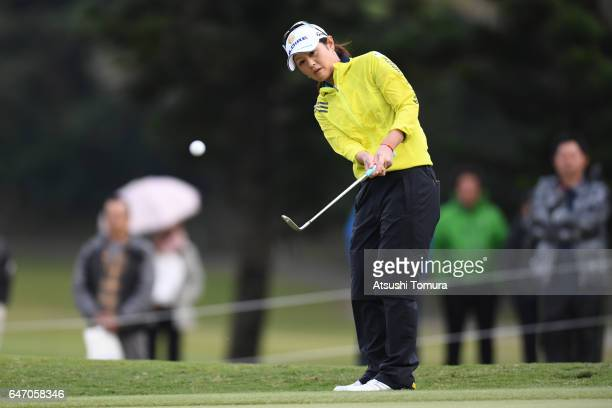 Shinobu Moromizato of Japan chips onto the 18th green during the first round of the Daikin Orchid Ladies Golf Tournament at the Ryukyu Golf Club on...