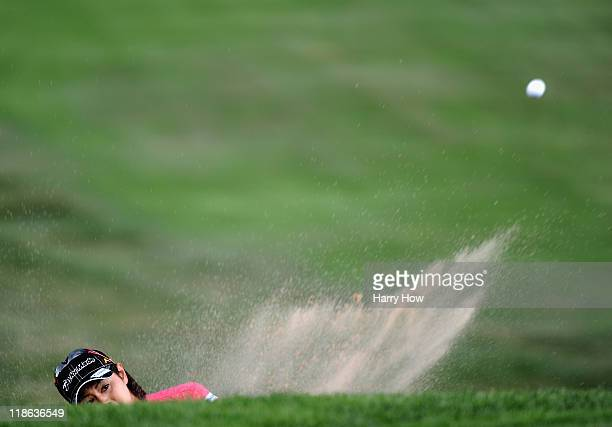Shinobu Moromizato of Japan hits out of the bunker on the 10th hole during the third round of the 2011 US Women's Open at The Broadmoor on July 9...