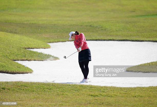 Shinobu Moromizato of Japan plays a bunker shot on the 18th hole during the second round of the Nobuta Group Masters GC Ladies at the Masters Gold...