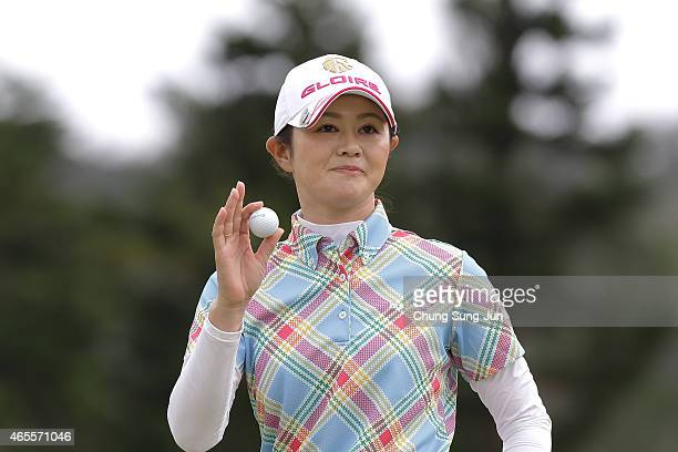 Shinobu Moromizato of Japan reacts after a putt during the final round of the Daikin Orchid Ladies Golf Tournament at the Ryukyu Golf Club on March 8...