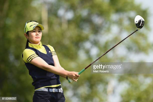 Shinobu Moromizato of Japan watches her tee shot on the 1st hole during the first round of the Nipponham Ladies Classics at the Ambix Hakodate Club...