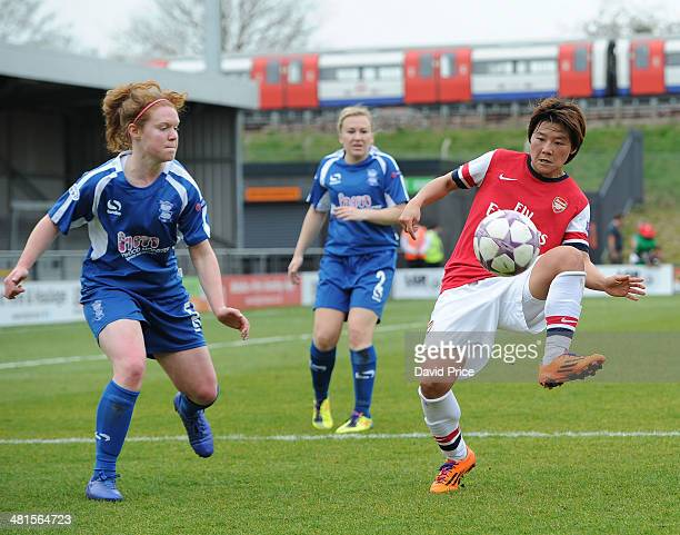 Shinobu Ohno of Arsenal Ladies controls the ball under pressure from Aoife Mannion of Birmingham during the match between Arsenal Ladies and...