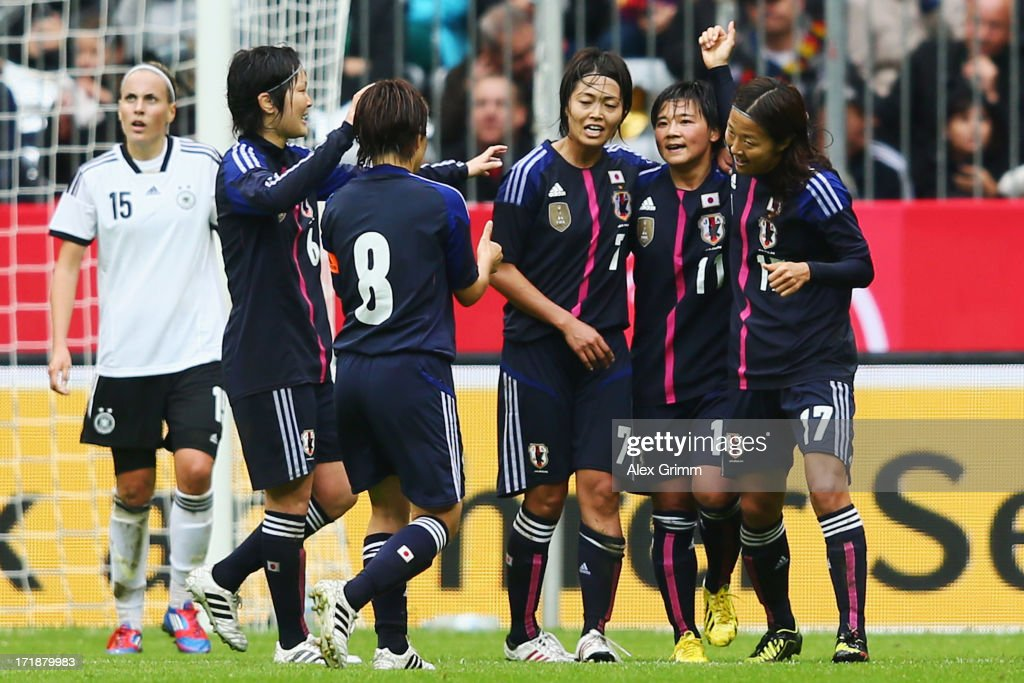 Shinobu Ohno (2R) of Japan celebrates her team's first goal with team mates during the Women's International Friendly match between Germany and Japan at Allianz Arena on June 29, 2013 in Munich, Germany.