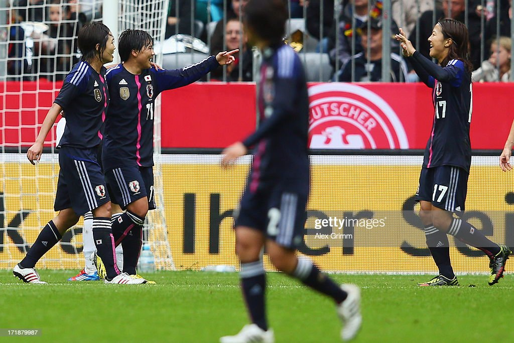 Shinobu Ohno (2L) of Japan celebrates her team's first goal with team mates during the Women's International Friendly match between Germany and Japan at Allianz Arena on June 29, 2013 in Munich, Germany.