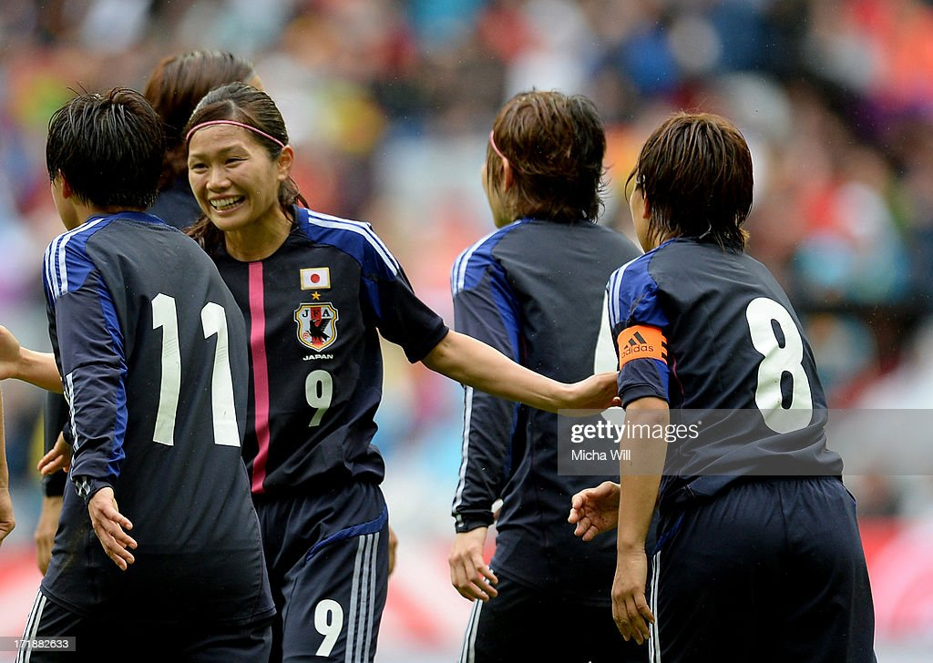 Shinobu Ohno (R) of Japan celebrates with team mates after scoring her team's first goal during the Women's International Friendly match between Germany and Japan at Allianz Arena on June 29, 2013 in Munich, Germany.