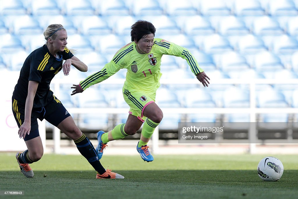 Shinobu Ohno of Japan challenges Amanda Ilestedt of Sweden during the Algarve Cup 2014 match between Japan and Sweden on March 10, 2014 in Loule, Portugal.