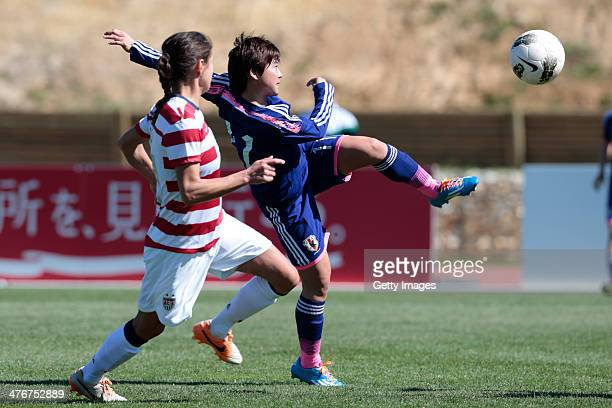 Shinobu Ohno of Japan challenges xxx of USA during the Algarve Cup 2014 match between Japan and USA on March 5 2014 in Parchal Portugal