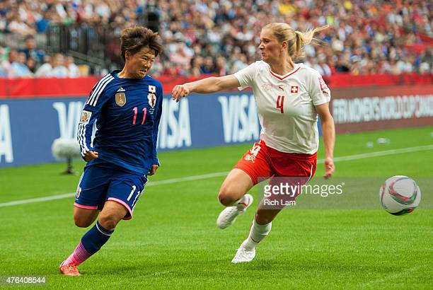 Shinobu Ohno of Japan tries to get past Rachel Rinast of Switzerland during the FIFA Women's World Cup Canada 2015 Group C match between Japan and...