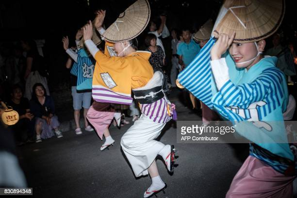 Shinomiya Kayo of Group Niji performs on a street during the Awa Odori festival in Tokushima on August 13 2017 The fourday dance festival attracts...