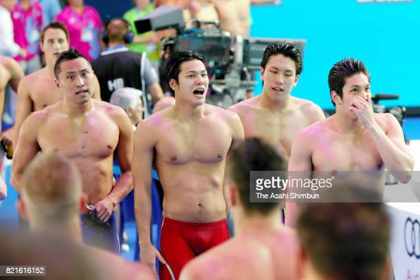 Shinri Shioura Katsumi Nakamura Katsuhiro Matsumoto and Junya Koga of Japan react after competing in the Men's 4x100m Freestyle Final on day ten of...