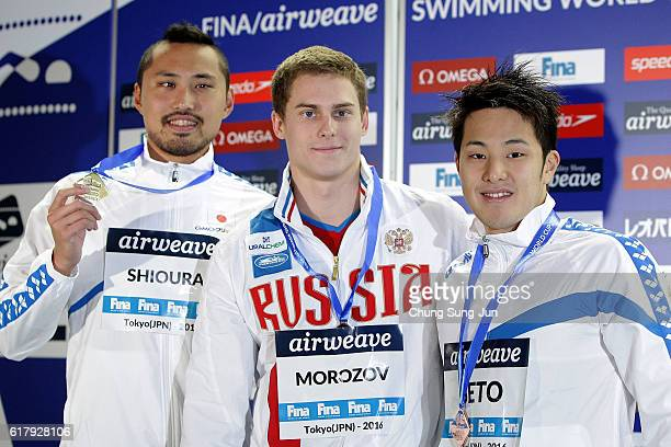 Shinri Shioura of Japan Vladimir Morozov of Russia and Daiya Seto of Japan pose on the podium after the Men's 100m Individual Medley final during the...