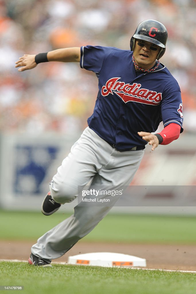 Shin-Sin Choo #17 of the Cleveland Indians runs past third base to home to scores teams first run during the first inning of a baseball game against the Baltimore Orioles at Oriole Park at Camden Yards on June 30, 2012 in Baltimore, Maryland.