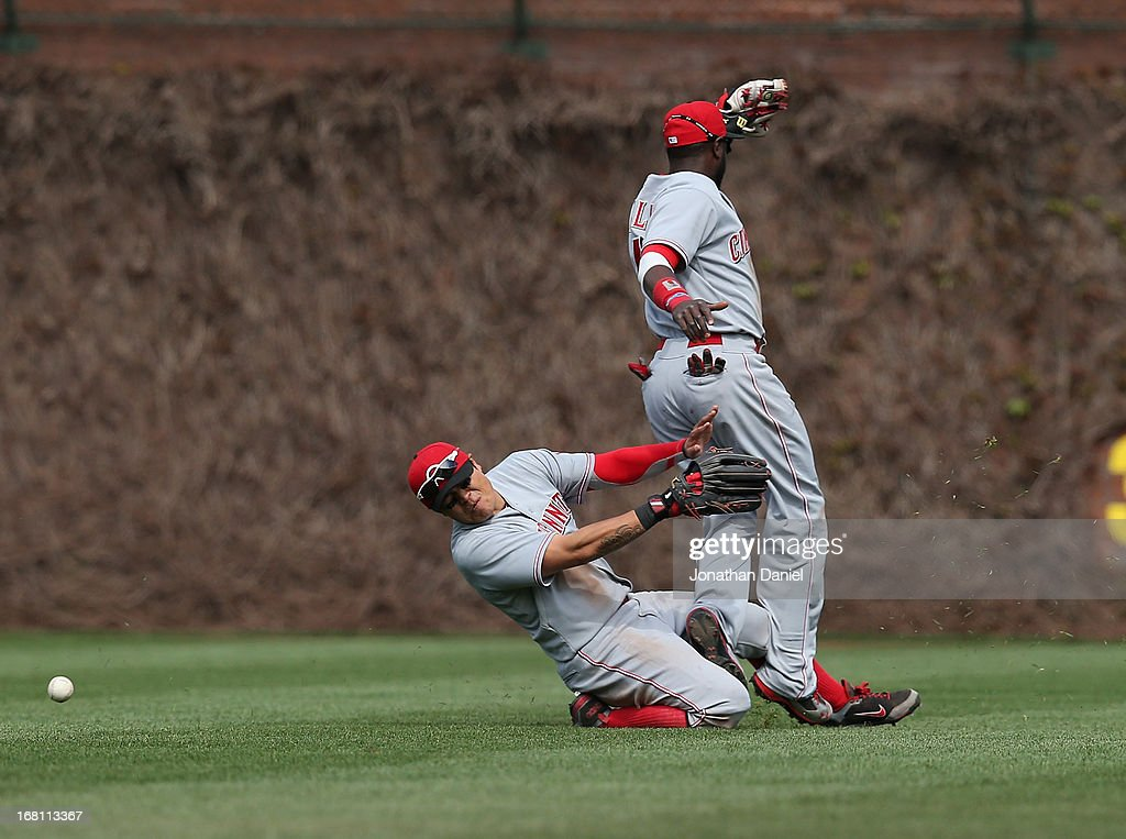 <a gi-track='captionPersonalityLinkClicked' href=/galleries/search?phrase=Shin-Soo+Choo&family=editorial&specificpeople=196543 ng-click='$event.stopPropagation()'>Shin-Soo Choo</a> #17 (L) and Brandon Phillips #4 of the Cincinnati Reds collide after trying to catch a ball hit by Alfonso Soriano of the Chicago Cubs at Wrigley Field on May 5, 2013 in Chicago, Illinois.