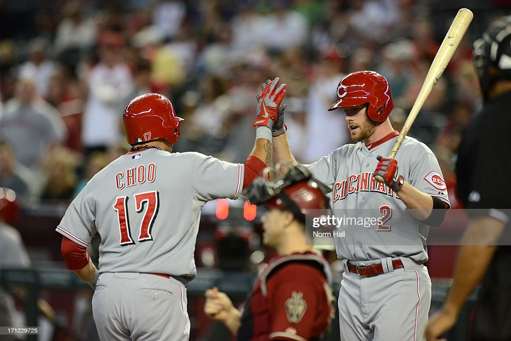 <a gi-track='captionPersonalityLinkClicked' href=/galleries/search?phrase=Shin-Soo+Choo&family=editorial&specificpeople=196543 ng-click='$event.stopPropagation()'>Shin-Soo Choo</a> #17 of the Cincinnati Reds and teammate Zach Cozart #2 celebrate Choo's lead off home run against the Arizona Diamondbacks at Chase Field on June 23, 2013 in Phoenix, Arizona.