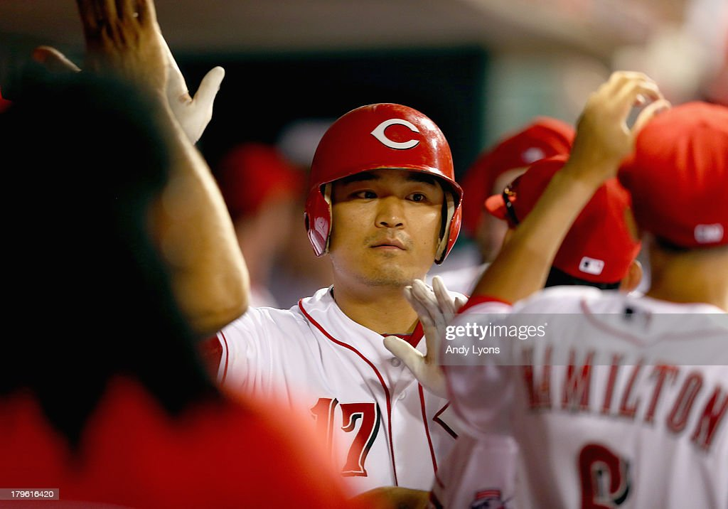 Shin-Soo Choo #17 of the Cincinnati Reds celebrates after hitting a home run in the 4th inning during the game against the St. Louis Cardinals at Great American Ball Park on September 5, 2013 in Cincinnati, Ohio.