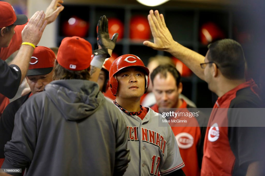 <a gi-track='captionPersonalityLinkClicked' href=/galleries/search?phrase=Shin-Soo+Choo&family=editorial&specificpeople=196543 ng-click='$event.stopPropagation()'>Shin-Soo Choo</a> #17 of the Cincinnati Reds celebrates in the dugout after scoring on a home run by Chris Heisey (not pictured) in the top of the fifth inning against the Milwaukee Brewers at Miller Park on August 16, 2013 in Milwaukee, Wisconsin.
