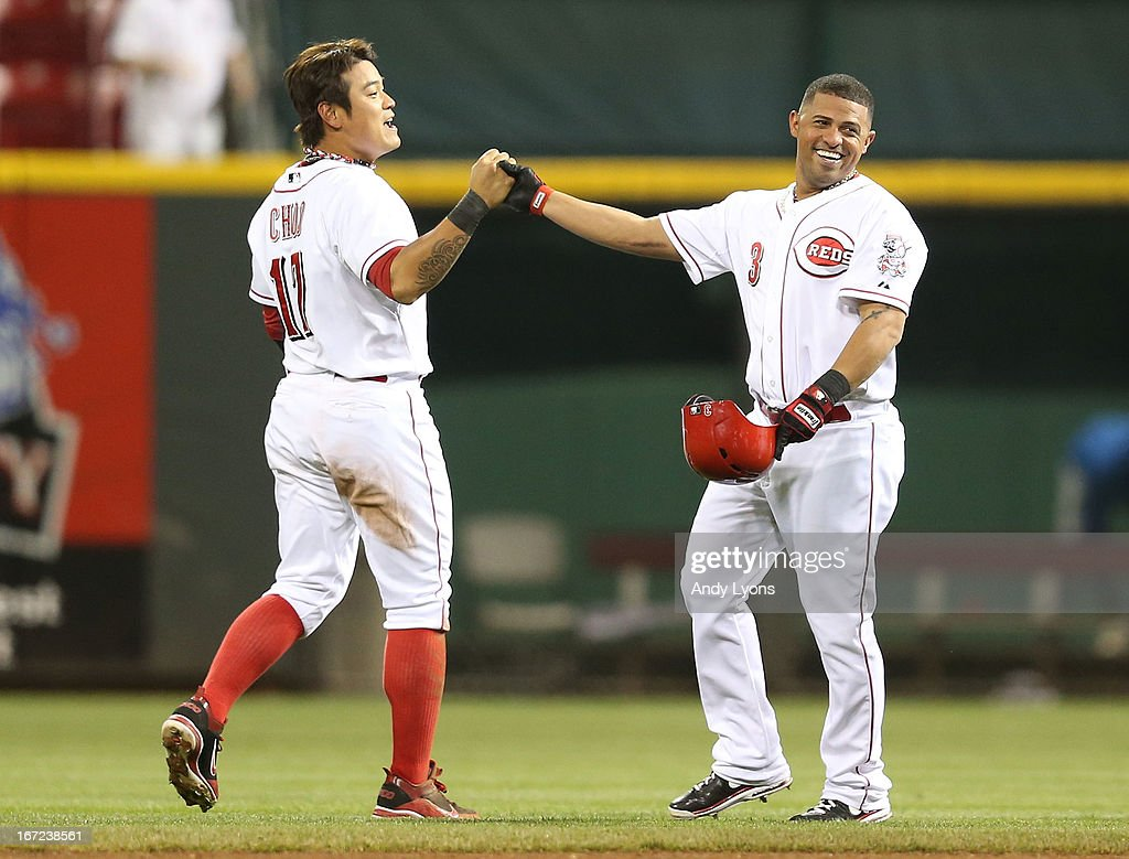 <a gi-track='captionPersonalityLinkClicked' href=/galleries/search?phrase=Shin-Soo+Choo&family=editorial&specificpeople=196543 ng-click='$event.stopPropagation()'>Shin-Soo Choo</a> #17 of the Cincinnati Reds celebrates with <a gi-track='captionPersonalityLinkClicked' href=/galleries/search?phrase=Cesar+Izturis&family=editorial&specificpeople=203148 ng-click='$event.stopPropagation()'>Cesar Izturis</a> #3 after Izturis hit the game winning single in the 13th inning to beat the Chicago Cubs 5-4 at Great American Ball Park on April 22, 2013 in Cincinnati, Ohio.