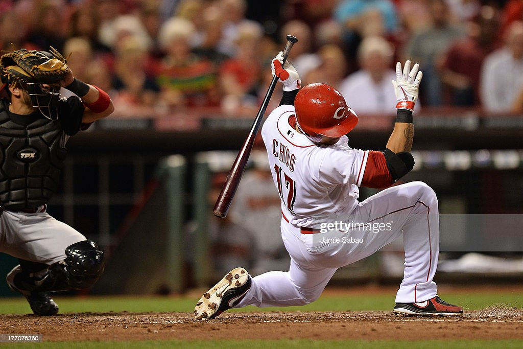 Shin-Soo Choo #17 of the Cincinnati Reds falls back to the ground to avoid an inside pitch near his face in the sixth inning against the Arizona Diamondbacks at Great American Ball Park on August 20, 2013 in Cincinnati, Ohio. Arizona defeated Cincinnati 5-2.