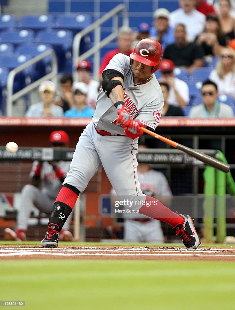 Shin-Soo Choo #17 of the Cincinnati Reds hits a home run in the fourth inning against the Miami Marlins at Marlins Park on May 15, 2013 in Miami, Florida.
