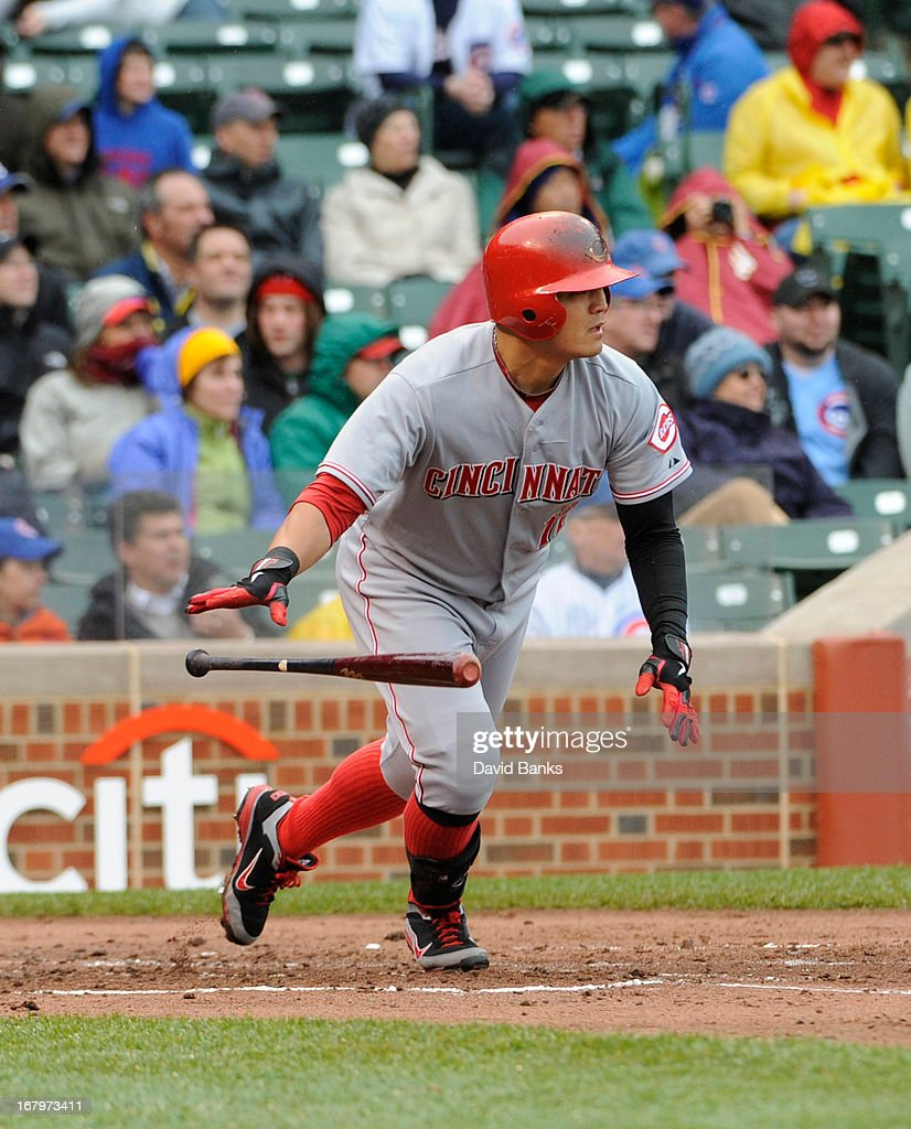 Shin-Soo Choo #17 of the Cincinnati Reds hits an RBI single against the Chicago Cubs during the second inning on May 3, 2013 at Wrigley Field in Chicago, Illinois.
