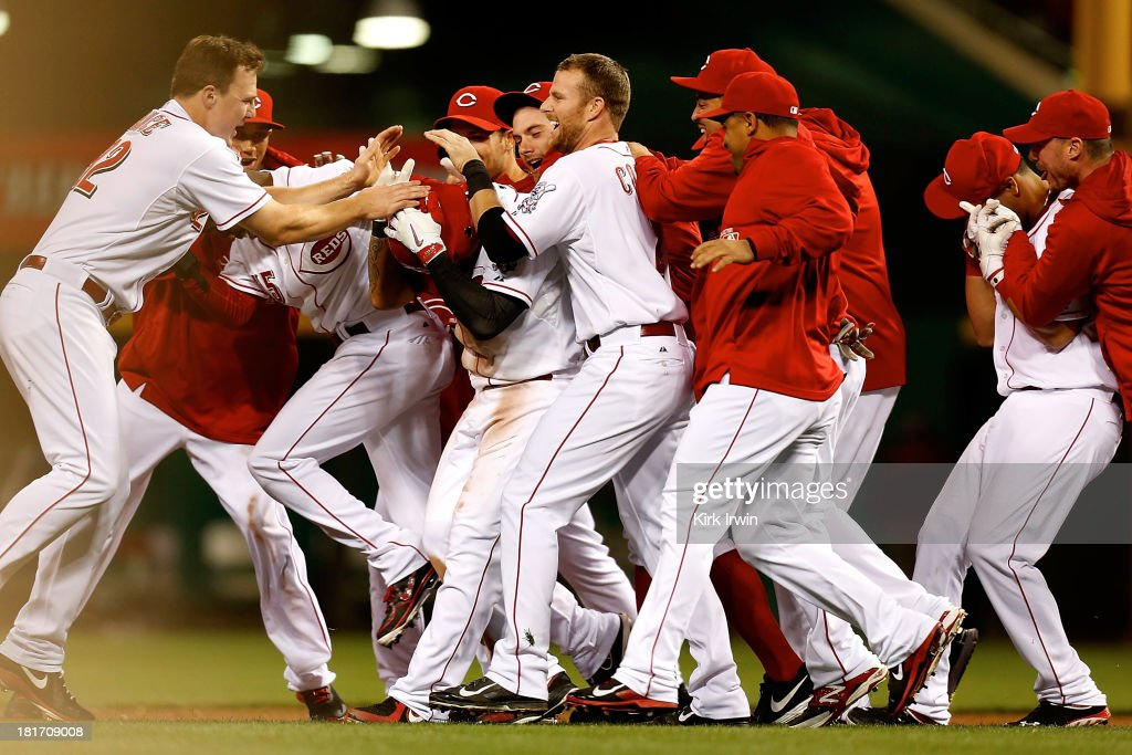 <a gi-track='captionPersonalityLinkClicked' href=/galleries/search?phrase=Shin-Soo+Choo&family=editorial&specificpeople=196543 ng-click='$event.stopPropagation()'>Shin-Soo Choo</a> #17 of the Cincinnati Reds is congratulated by his teammates after hitting a walk-off double to defeat the New York Mets 3-2 in the 10th inning at Great American Ball Park on September 23, 2013 in Cincinnati, Ohio.