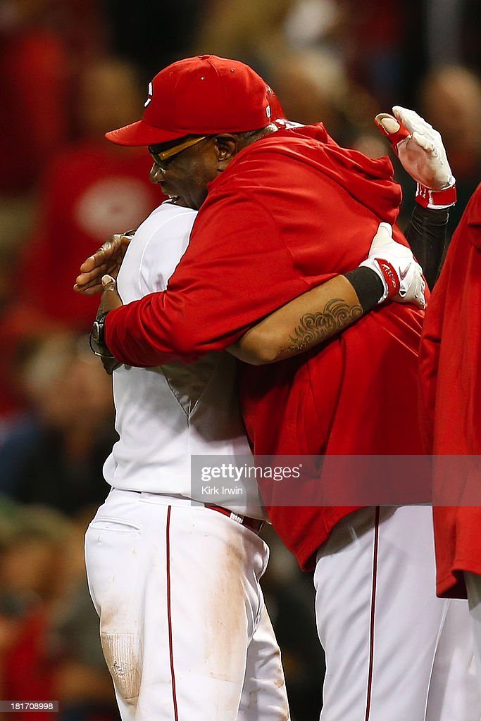 Shin-Soo Choo #17 of the Cincinnati Reds is congratulated by Manager Dusty Baker of the Cincinnati Reds after hitting a walk-off double to defeat the New York Mets 3-2 in the 10th inning at Great American Ball Park on September 23, 2013 in Cincinnati, Ohio.