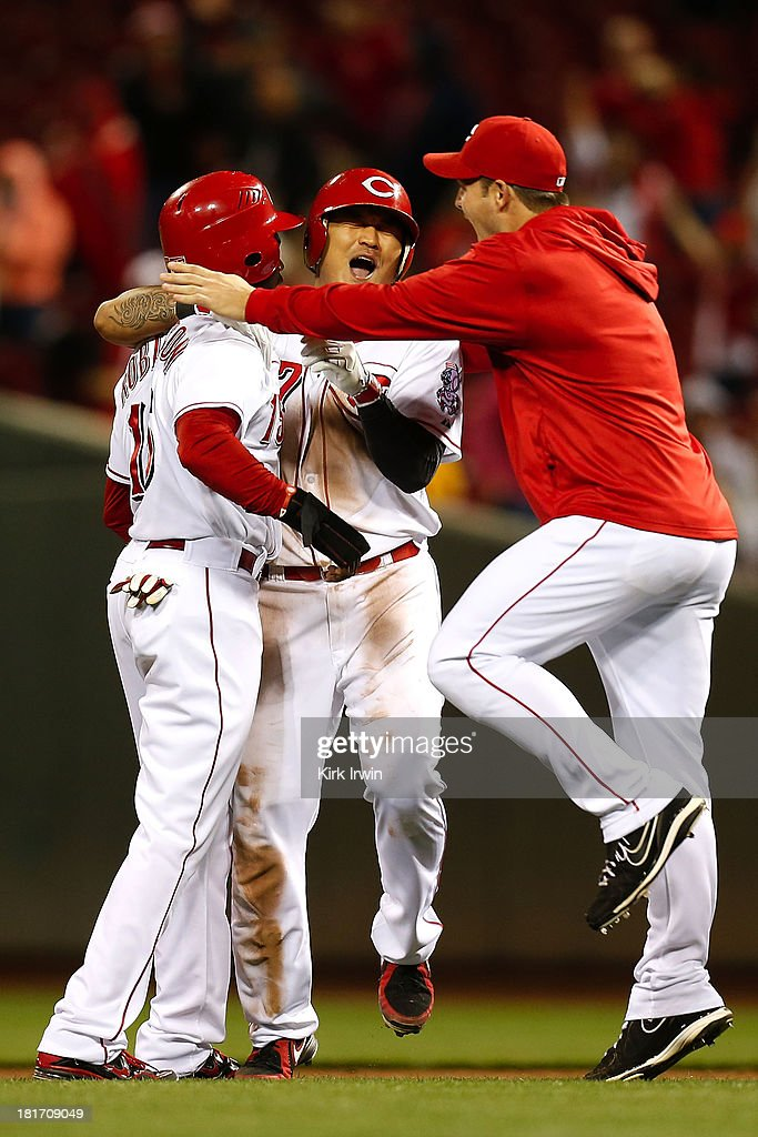 <a gi-track='captionPersonalityLinkClicked' href=/galleries/search?phrase=Shin-Soo+Choo&family=editorial&specificpeople=196543 ng-click='$event.stopPropagation()'>Shin-Soo Choo</a> #17 of the Cincinnati Reds is congratulated by teammates after hitting a walk-off double to defeat the New York Mets 3-2 in the 10th inning at Great American Ball Park on September 23, 2013 in Cincinnati, Ohio.