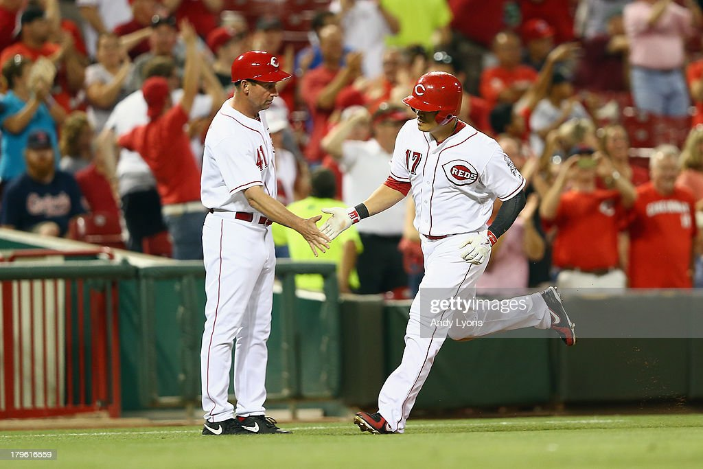 Shin-Soo Choo #17 of the Cincinnati Reds is congratulated by third base coach Mark Berry #41 after hitting a home run in the 4th inning during the game against the St. Louis Cardinals at Great American Ball Park on September 5, 2013 in Cincinnati, Ohio.