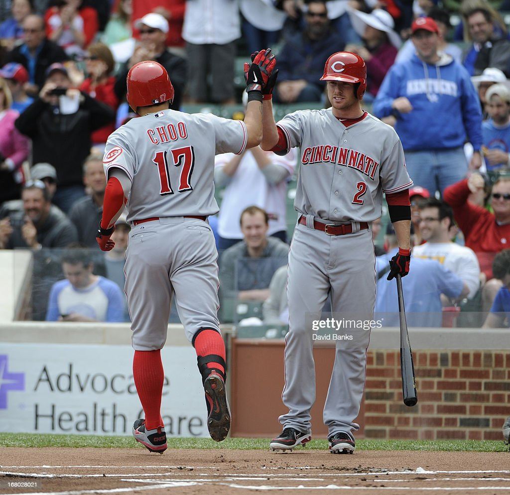 Shin-Soo Choo #17 of the Cincinnati Reds is greeted by Zack Cozart #2 after hitting a home run against the Chicago Cubs during the first inning on May 4, 2013 at Wrigley Field in Chicago, Illinois.