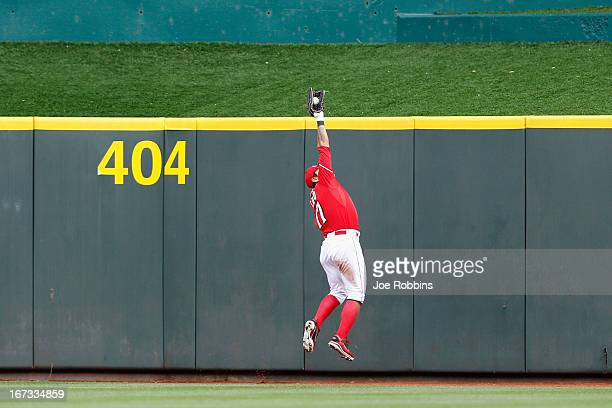 ShinSoo Choo of the Cincinnati Reds makes a catch against the center field wall to rob a hit from Anthony Rizzo of the Chicago Cubs during the game...
