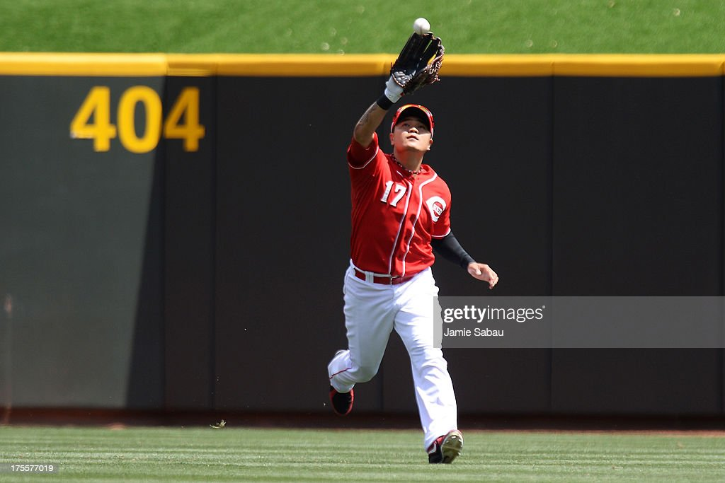 <a gi-track='captionPersonalityLinkClicked' href=/galleries/search?phrase=Shin-Soo+Choo&family=editorial&specificpeople=196543 ng-click='$event.stopPropagation()'>Shin-Soo Choo</a> #17 of the Cincinnati Reds makes a catch in center field in the seventh inning against the St. Louis Cardinals at Great American Ball Park on August 4, 2013 in Cincinnati, Ohio. St. Louis defeated Cincinnati 15-2.