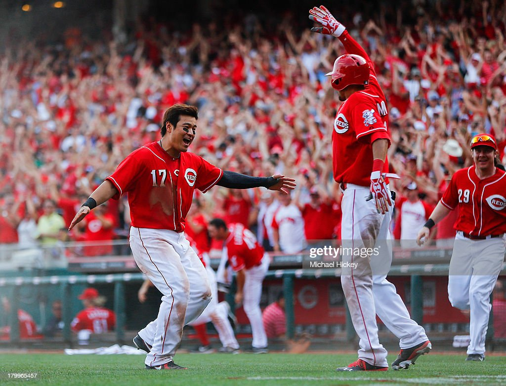 <a gi-track='captionPersonalityLinkClicked' href=/galleries/search?phrase=Shin-Soo+Choo&family=editorial&specificpeople=196543 ng-click='$event.stopPropagation()'>Shin-Soo Choo</a> #17 of the Cincinnati Reds runs to congratulate Billy Hamilton #6 of the Cincinnati Reds for scoring the winning run in the tenth inning against the Los Angeles Dodgers at Great American Ball Park on September 7, 2013.