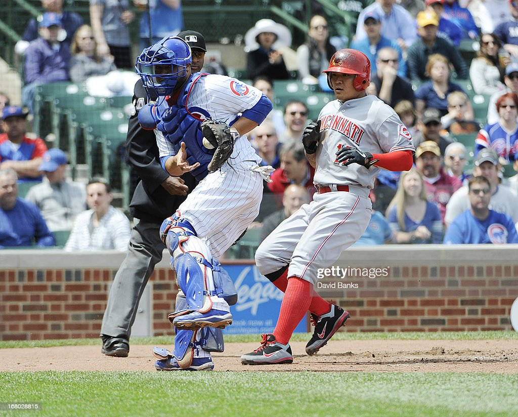 <a gi-track='captionPersonalityLinkClicked' href=/galleries/search?phrase=Shin-Soo+Choo&family=editorial&specificpeople=196543 ng-click='$event.stopPropagation()'>Shin-Soo Choo</a> #17 of the Cincinnati Reds scores a run as <a gi-track='captionPersonalityLinkClicked' href=/galleries/search?phrase=Welington+Castillo&family=editorial&specificpeople=4959193 ng-click='$event.stopPropagation()'>Welington Castillo</a> #53 of the Chicago Cubs taies a late throw during the third inning on May 4, 2013 at Wrigley Field in Chicago, Illinois.