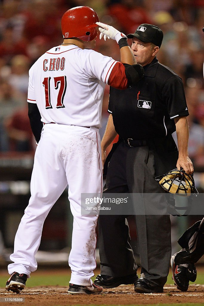 Shin-Soo Choo #17 of the Cincinnati Reds shows home plate umpire Jerry Meals how close a pitch came to his face in the sixth inning against the Arizona Diamondbacks at Great American Ball Park on August 20, 2013 in Cincinnati, Ohio. Arizona defeated Cincinnati 5-2.