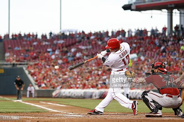 ShinSoo Choo of the Cincinnati Reds singles to drive in two runs in the second inning of the game against the Arizona Diamondbacks at Great American...