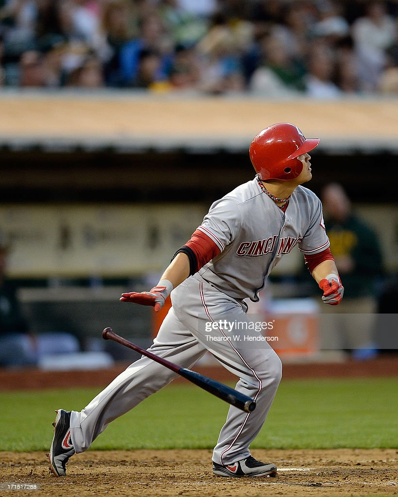 Shin-Soo Choo #17 of the Cincinnati Reds watches the flight of his ball go to the left field wall for a sacrifice fly scoring Cesar Izuris #3 in the fourth inning against the Oakland Athletics at O.co Coliseum on June 25, 2013 in Oakland, California.