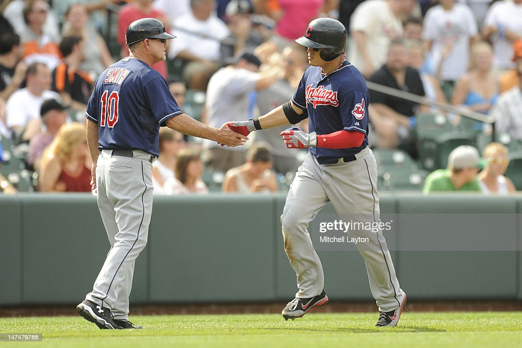 <a gi-track='captionPersonalityLinkClicked' href=/galleries/search?phrase=Shin-Soo+Choo&family=editorial&specificpeople=196543 ng-click='$event.stopPropagation()'>Shin-Soo Choo</a> #17 of the Cleveland Indians celebrates a solo home run with third base coach Steve Smith #10 during the second inning of a baseball game against the Baltimore Orioles at Oriole Park at Camden Yards on June 30, 2012 in Baltimore, Maryland.