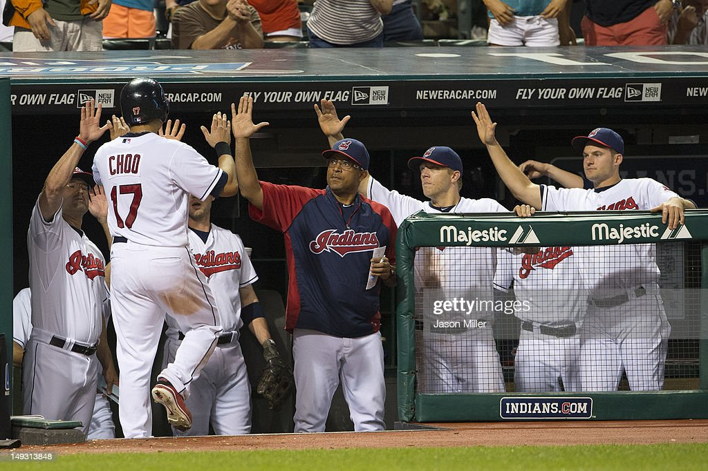 <a gi-track='captionPersonalityLinkClicked' href=/galleries/search?phrase=Shin-Soo+Choo&family=editorial&specificpeople=196543 ng-click='$event.stopPropagation()'>Shin-Soo Choo</a> #17 of the Cleveland Indians celebrates with his teammates in the dugout after scoring during the seventh inning against the Detroit Tigers at Progressive Field on July 26, 2012 in Cleveland, Ohio.
