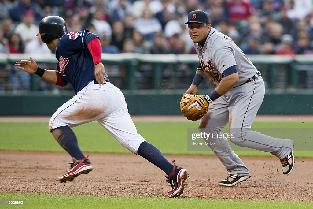 <a gi-track='captionPersonalityLinkClicked' href=/galleries/search?phrase=Shin-Soo+Choo&family=editorial&specificpeople=196543 ng-click='$event.stopPropagation()'>Shin-Soo Choo</a> #17 of the Cleveland Indians runs to third as third baseman <a gi-track='captionPersonalityLinkClicked' href=/galleries/search?phrase=Miguel+Cabrera&family=editorial&specificpeople=202141 ng-click='$event.stopPropagation()'>Miguel Cabrera</a> #24 of the Detroit Tigers throws out Asdrubal Cabrera (not shown) #13 of the Cleveland Indians during the third inning at Progressive Field on May 22, 2012 in Cleveland, Ohio.