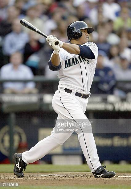 ShinSoo Choo of the Seattle Mariners makes a hit during the game against the Los Angeles Angels of Anaheim on July 5 2006 at Safeco Field in Seattle...
