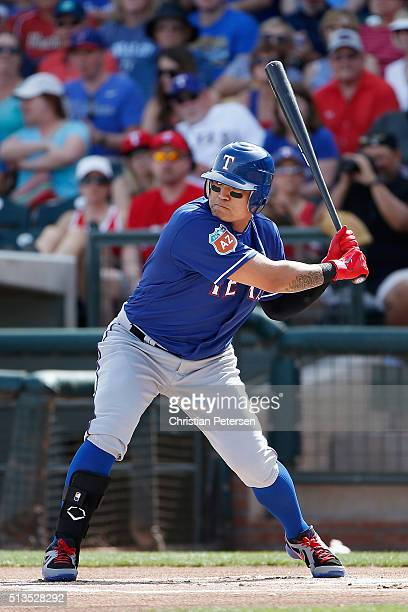 ShinSoo Choo of the Texas Rangers bats against the Kansas City Royals during the cactus leauge spring training game at Surprise Stadium on March 2...
