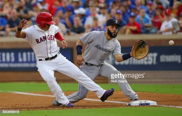 ShinSoo Choo of the Texas Rangers beats the tat on first base against Marwin Gonzalez of the Houston Astroscat Globe Life Park in Arlington on August...