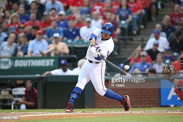 ShinSoo Choo of the Texas Rangers bitt a foul tip in the first inning against the Philadelphia Phillies at Globe Life Park in Arlington on April 2...