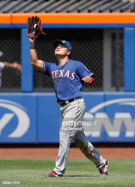 ShinSoo Choo of the Texas Rangers catches a fly ball in an interleague MLB baseball game against the New York Mets on August 9 2017 at CitiField in...
